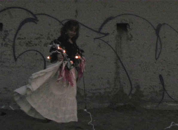 Video still from performance at Ocean Beach, San Francisco, California