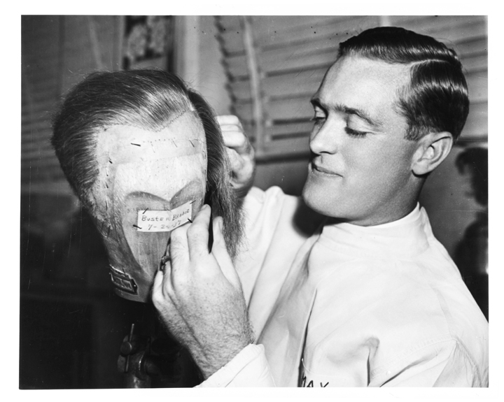 Charlie Wright working on lace front wig for actor Buster Brodie in 1937