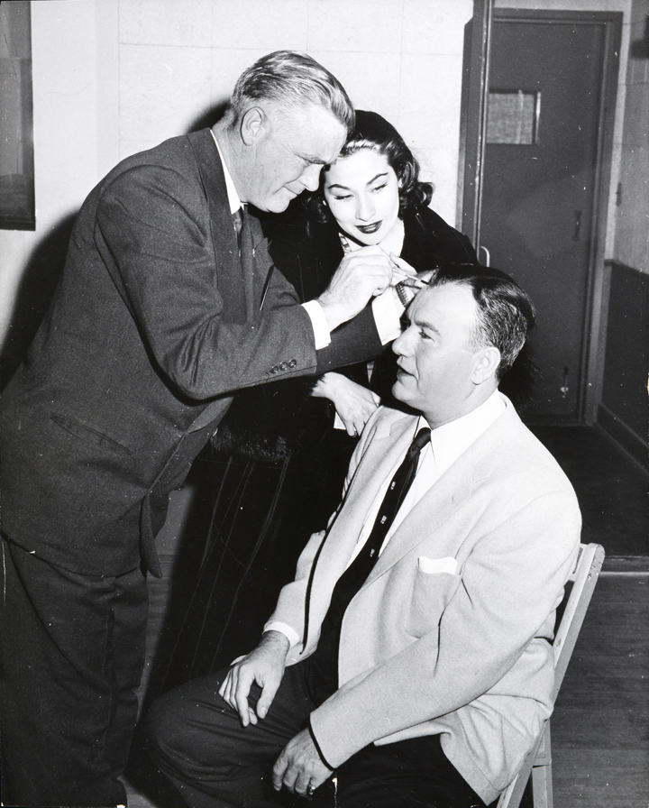 Charlie applying lace front hairpiece for Larry Finley. The Larry Finley Show was popular in the 1950's.